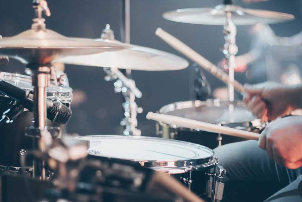 adult drummer performing on stage