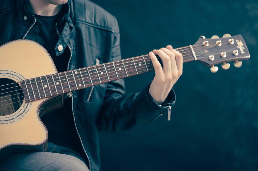 Acoustic guitarist performing