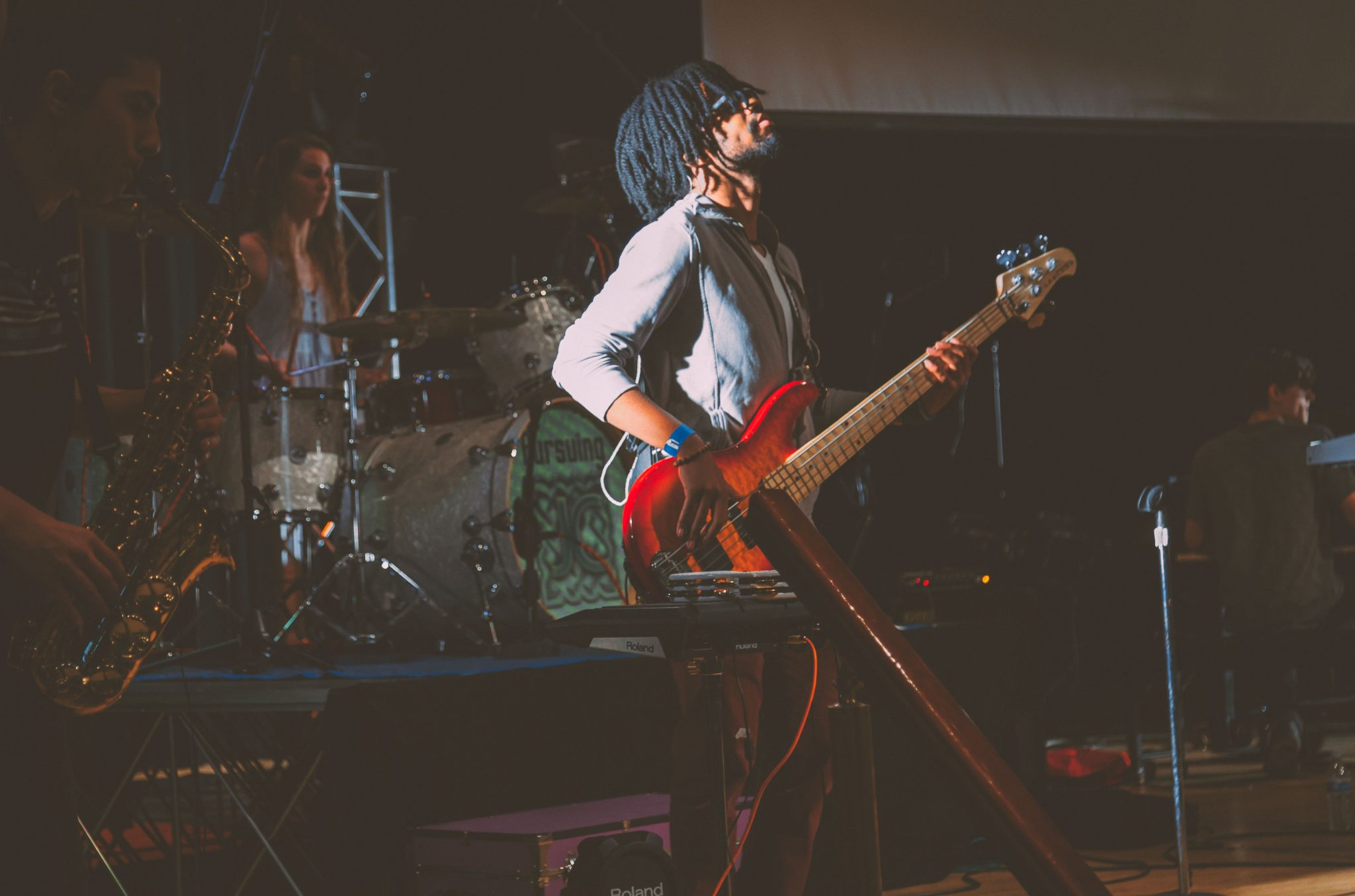 bassist performing live