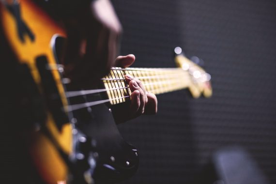bass guitarist rehearsing material