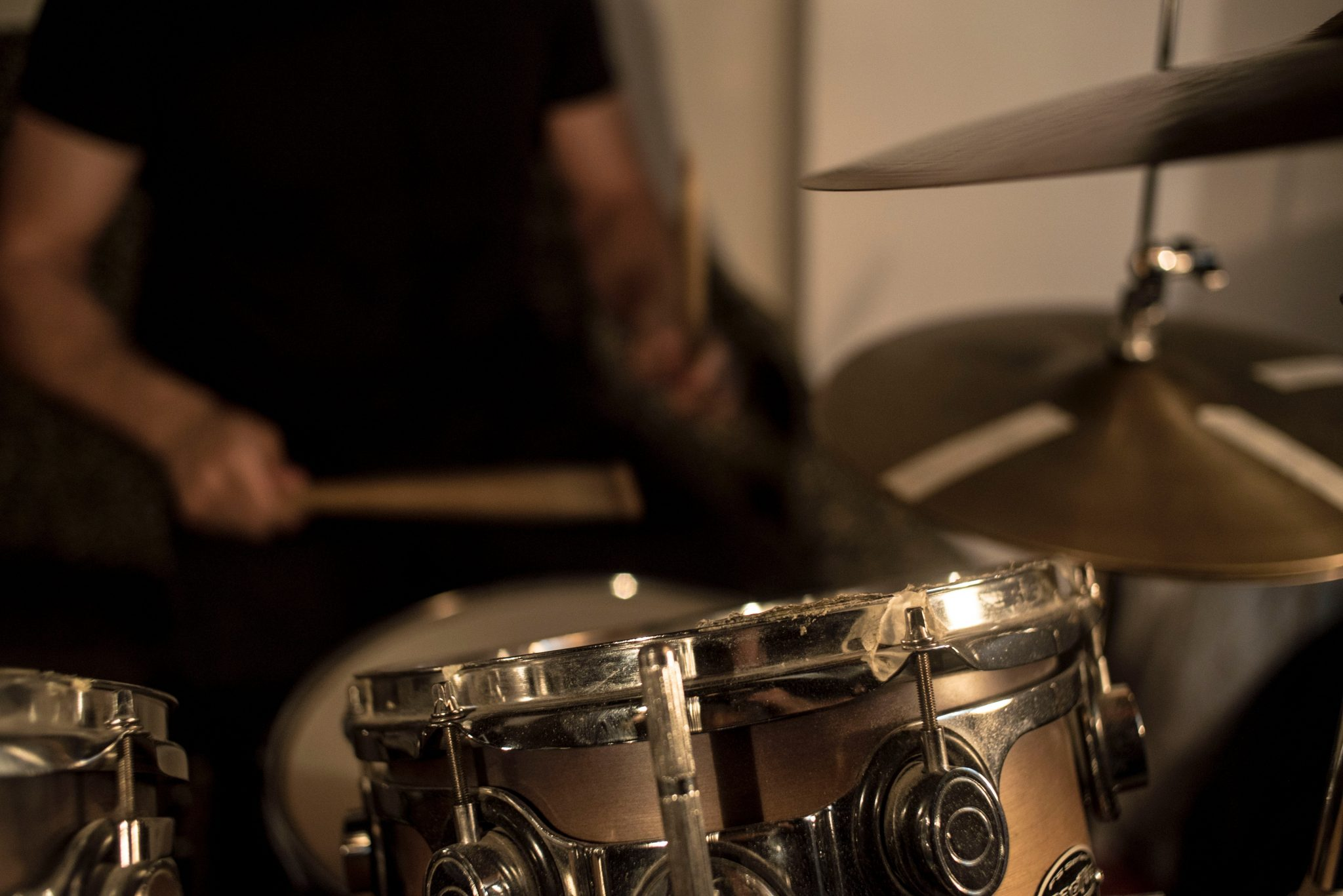 blurred photo of drummer performing