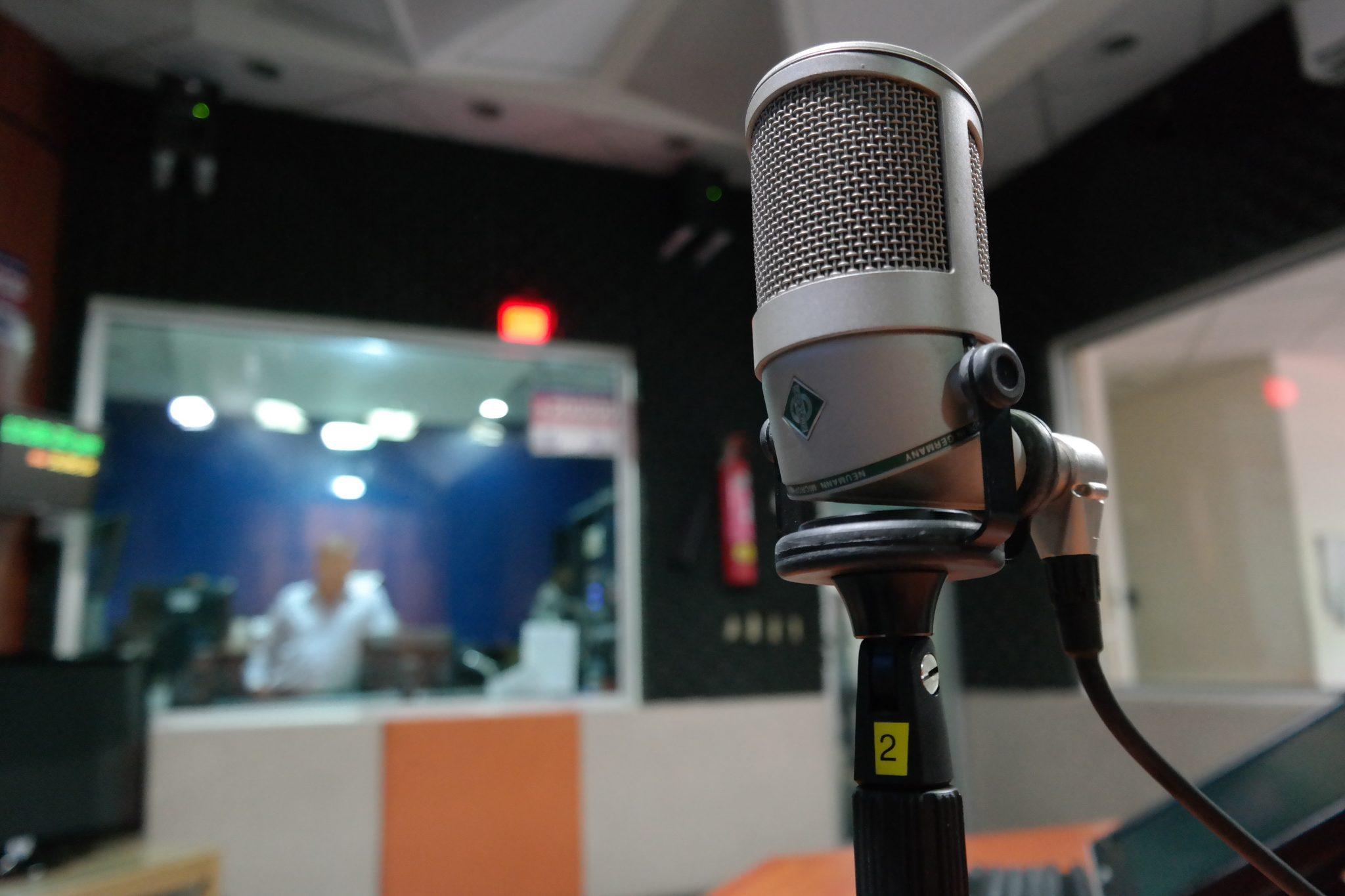 Grey condenser microphone in recording studio