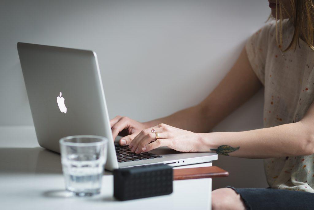 adult businesswoman working on apple mac