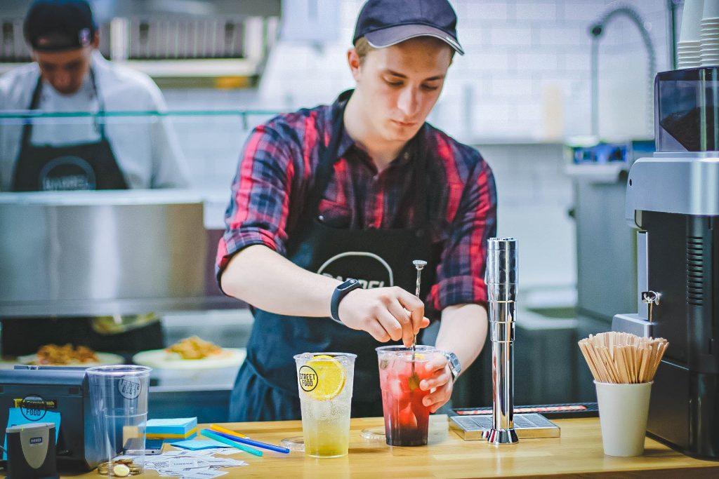 barista serving drinks