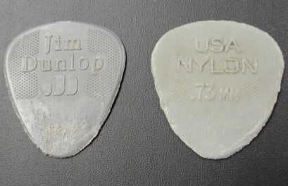nylon guitar picks displaying severe signs of wear
