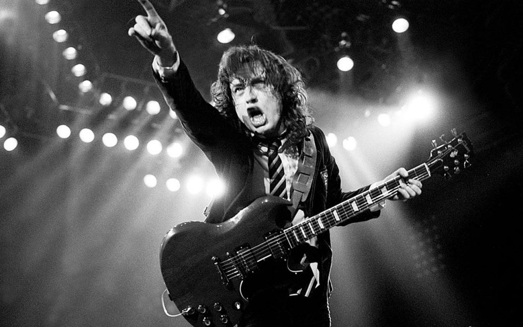 Angus Young making a 'guitar face'