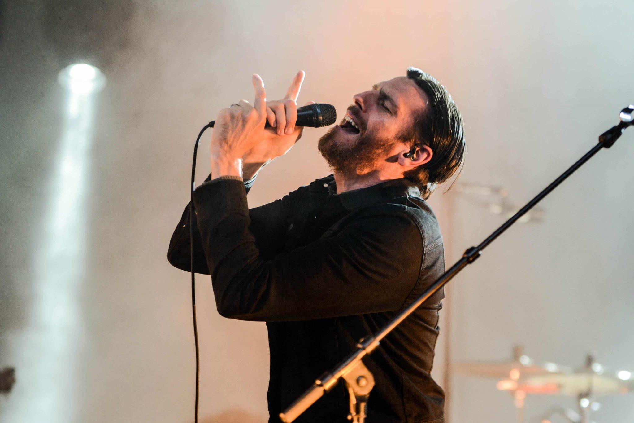 singer wearing in ear monitors