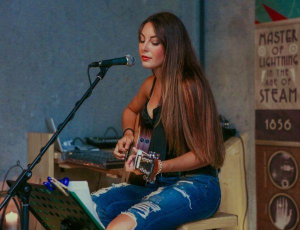 woman playing ukulele and singing