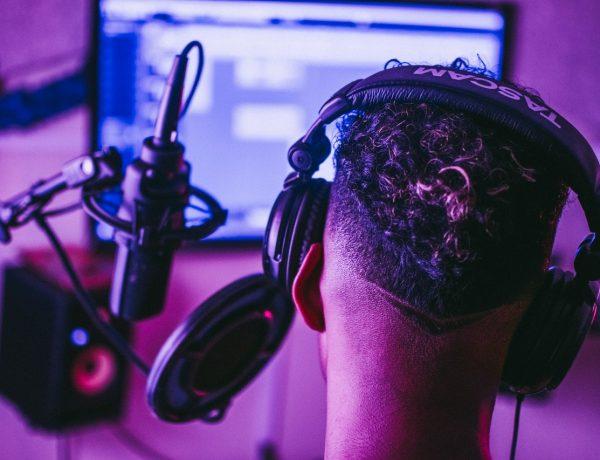 Man recording vocal track in home studio