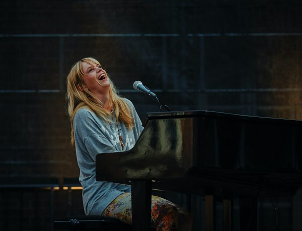 Woman playing piano and laughing