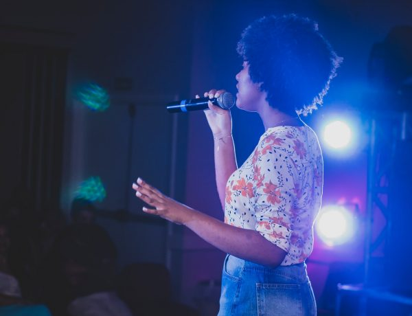 woman singing on stage
