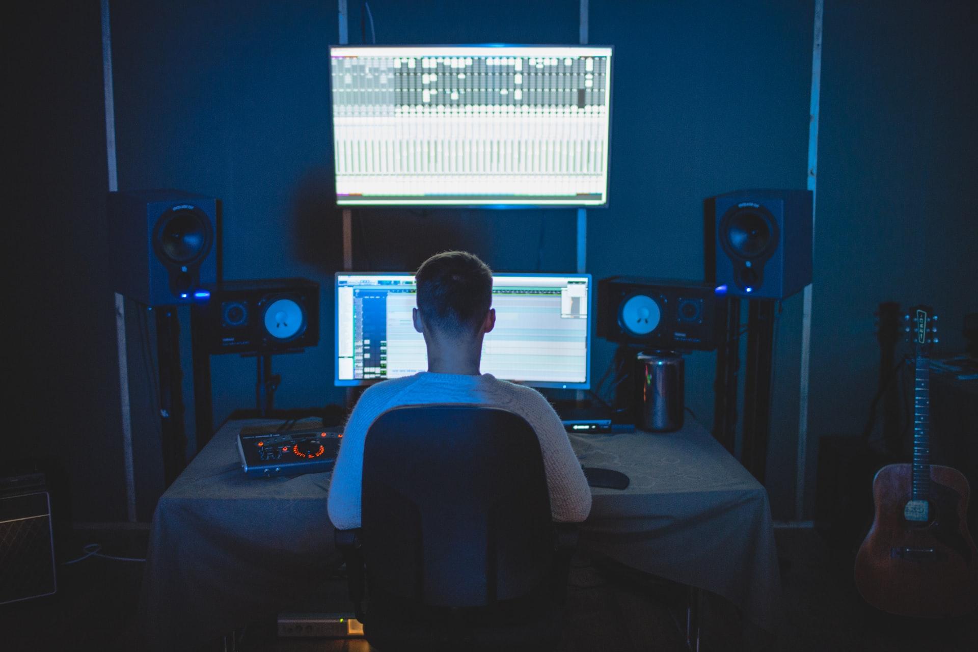 man writing music in home studio