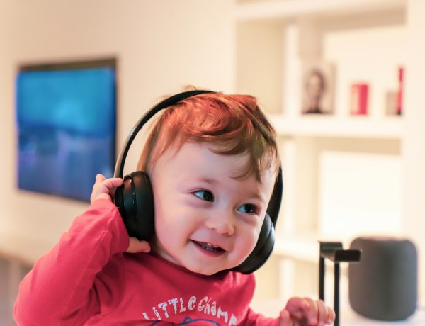 child wearing headphones and smiling