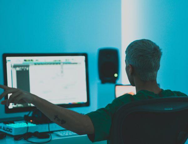 man composing in home studio
